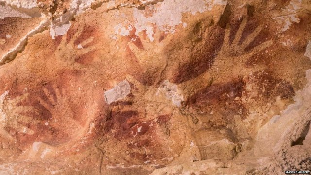Hand stencils from Timpuseng cave, near the town of Maros, in the province of  South Sulawesi, Indonesia.
